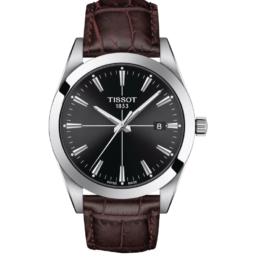 Tissot - Gentleman – Urets vandtæthed 10ATM / 100 meter. Uret har safir glas, stålurkasse, brun læderrem og sort urskive.