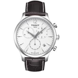 Tissot - Tradition Chronograph – Urets vandtæthed 3ATM / 30 meter. Uret har safir glas, stålurkasse, brun læderrem og hvid urskive.